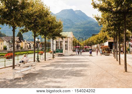 Bad Ischl Austria - September 2 2016: An esplanade along the Traun river in the austrian resort town Bad Ischl Katrin mountain on the background.