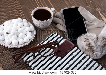 Cranberries in the sugar coffee gloves phone glasses notebook