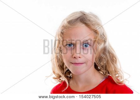 Blond Girl Looking Skeptical With Eyebrow Up