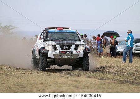 Speeding White And Black Nissan Navara Rally Car Front View