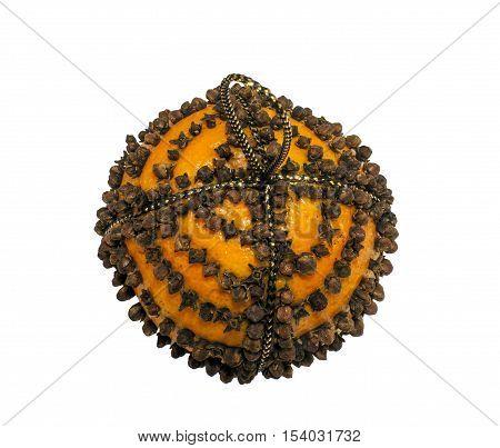 Orange Pomander studded with cloves on a white background