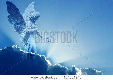 Beautiful angel in heaven with divine rays of light