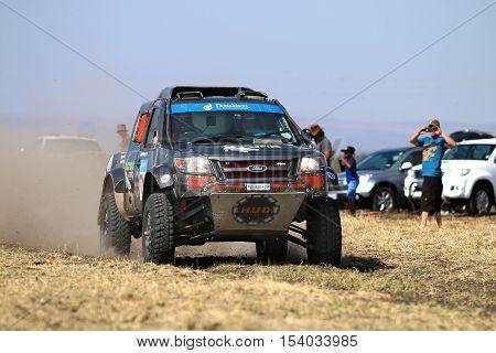 Speeding Black Ford Ranger Rally Car Front View