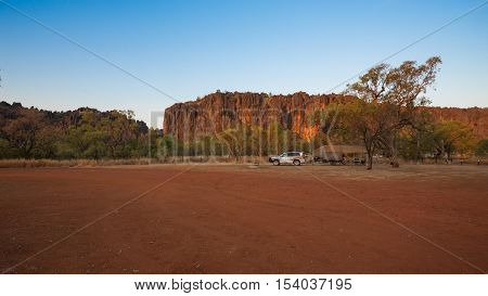 Wide angle image of off road camper trailer and four wheel drive vehicle in campground at Windjana Gorge in the Kimberley