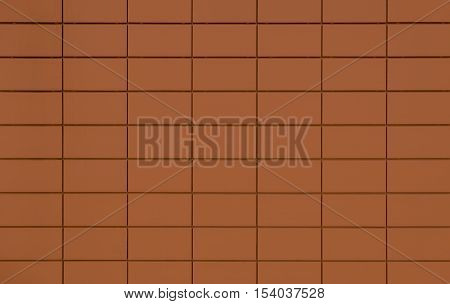 View of a orange tiled wall suitable for backgrounds