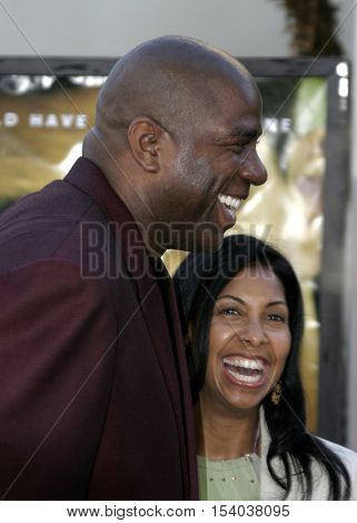 Earvin 'Magic' Johnson and wife Cookie at the Los Angeles premiere of 'The Bourne Supremacy' held at the Cinerama Dome in Hollywood, USA on July 16, 2004.