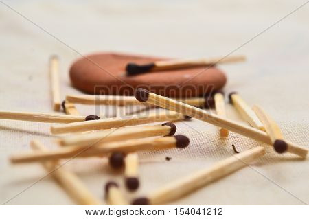 Match with orange stone. Still life with wooden matches.