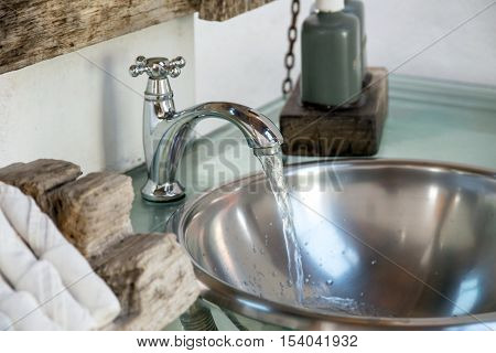 Water leaking from faucet, water save - Stock Photo