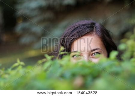 shy glance from a woman behind the bushes.