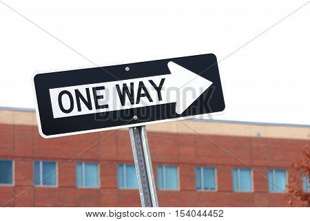 one way sign in front industry building