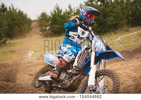 24 september 2016 - Volgsk, Russia, MX moto cross racing - Girl Bike Rider rides on a motorcycle and throwing a spray of dirt, close up, telephoto