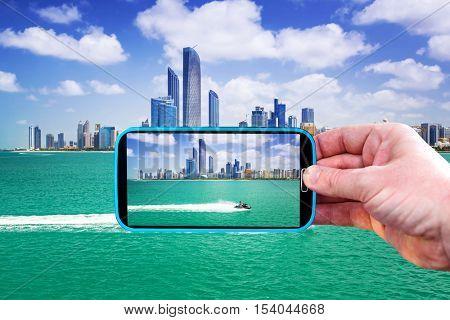 Making photos by smartphone in Abu Dhabi, UAE