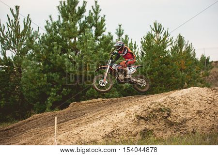 24 september 2016 - Volgsk, Russia, MX moto cross racing - jump motorcycle, telephoto