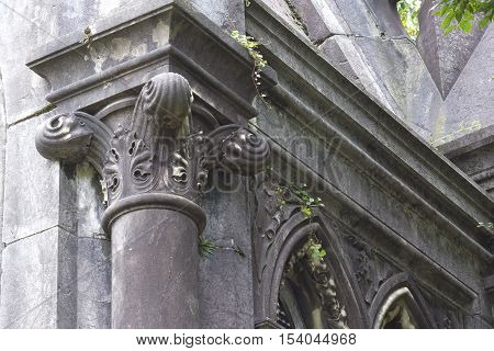 Closeup image of a column capital with floral volutes.