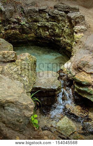 Mountain source of clean water . Mountain stream and lake with clear pure water