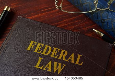 Book with title federal law on a table.