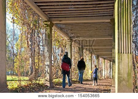 TSARSKOYE SELO, SAINT - PETERSBURG, RUSSIA - OCTOBER 19, 2016: People walk in the Italian style pergola in the Private Garden of The Catherine Park. The Tsarskoye Selo is The State Museum Preserve.