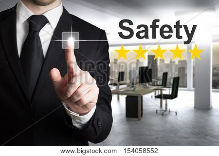 businessman in office pushing button safety five star rating