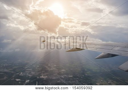 View Of The Sunset With Clouds, Ray And Airplane Wing From The Airplane Window