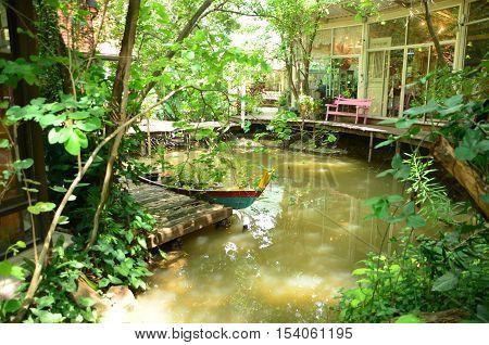 Pond under shady tree and sun light