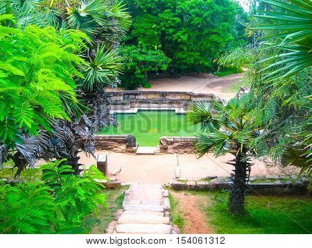 The pond at Polonnaruwa temple - medieval capital of Ceylon or Sri Lanka Asia UNESCO