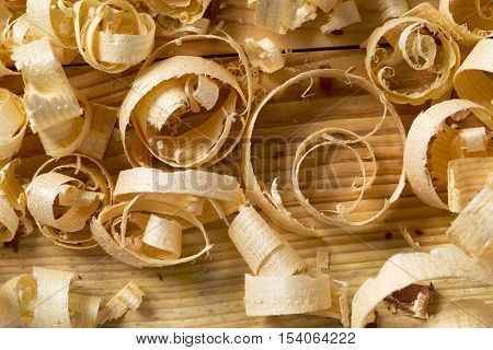 Carpenter tools on wood table background with sawdust. Copy space,