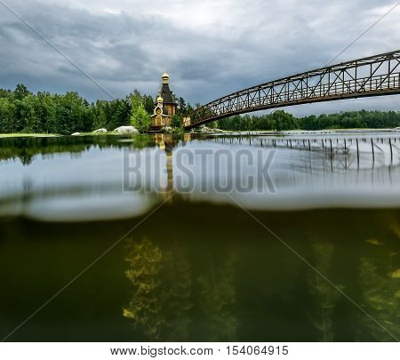 Karelia.Russia.15 Aug 2016 .View of the Church of St. Andrew on the island on the lake Vuoksa in Karelia the view over the water and under water