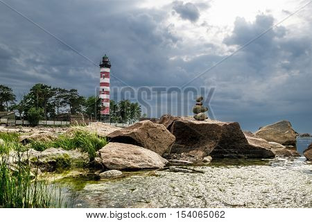 Shepelevsky Cape.Russia.27 Jun 2016.Shepelevsky lighthouse on the Gulf of Finland in Leningrad region in cloudy weather.