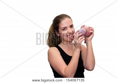 Young women eating a piece of fresh meat. Isolated photo on white background
