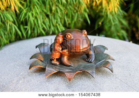 New York City - May 19, 2012: Small frog sculpture in Battery Park City: Nelson A. Rockefeller Park - The Real World.