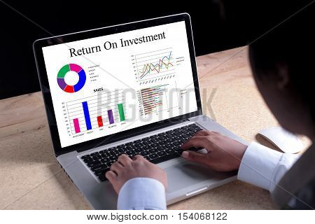 Return On Investment chart on laptop screen. Business banking finance and investment concept.