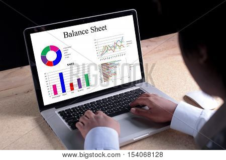 Balance Sheet chart on laptop screen. Business banking finance and investment concept.