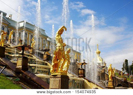 SAINT-PETERSBURG, RUSSIA - AUGUST 16, 2012: Grand Petergof Palace Cascade Fountains are one of the most famous Russian tourist attractions.