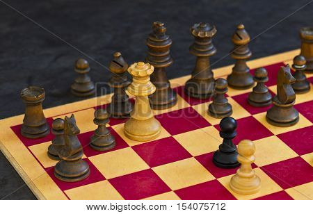 White queen brings a checkmate move against black in a chess game