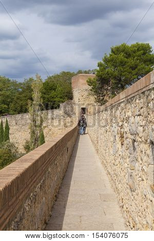 GIRONA,SPAIN -OCTOBER 12, 2016: historic center of Girona -  medieval walls, Catalonia, Spain