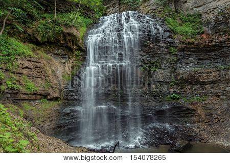 Stunning gorgeous amazing view of Niagara escarpment green belt water fall background