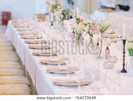 Wedding decor. Wedding interior. Festive decor. Bouquet from spring flowers. Wedding bouquet.  Table decor. Table layout. Pastel tone. Restaurant interior.