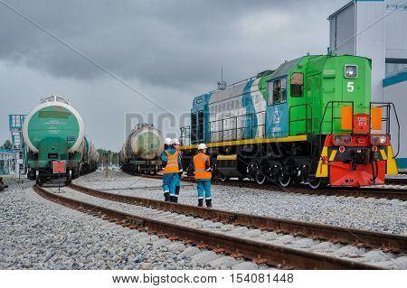 Tobolsk, Russia - July 15. 2016: Sibur company. Workers on railway station