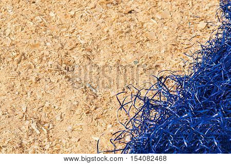background of yellow decorative blue sisal and sawdust.