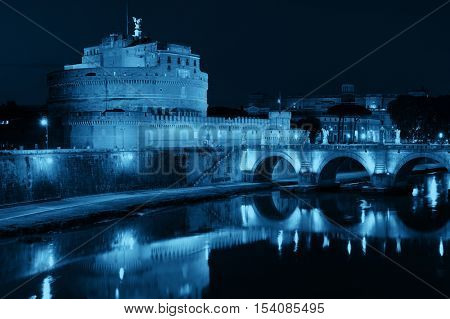 Castel Sant Angelo and bridge over River Tiber at night in Rome, Italy.