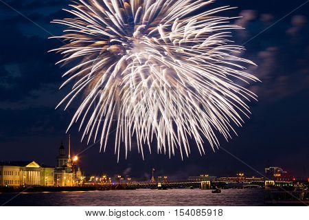 White fireworks over Neva river view to Spit of Vasilyevsky Island at victory day, 9th may. Fireworks have long sparkles beside cloud at night. Saint Petersburg, Russian. poster
