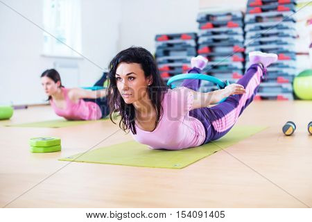 Fit woman stretching training back extension exercise