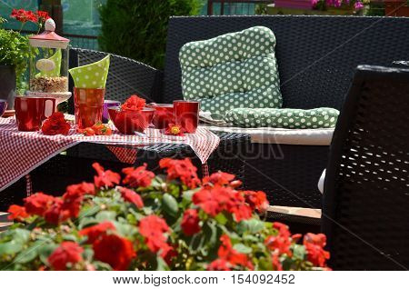 Lush Garden Flowers And A Garden Set