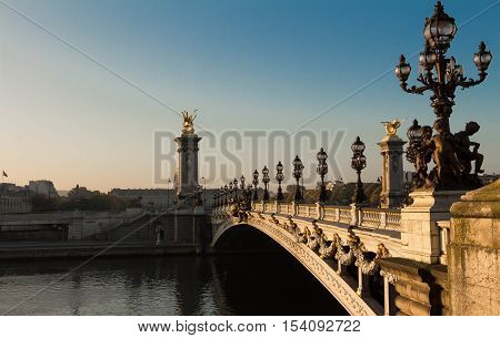 The bridge Alexandre III is a deck arch bridge that spans the Seine in Paris.It is widely regarded as the most ornate and extravagaht bridge in the city.It is classified as French historic monument.