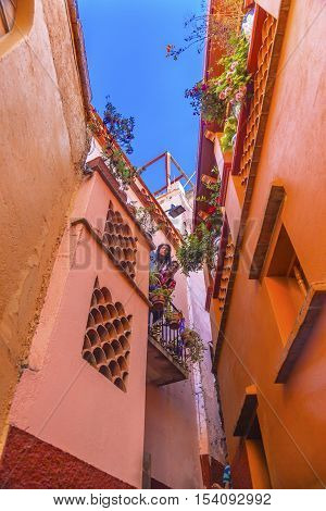 GUANAJUATO, MEXICO - DECEMBER 31, 2014Kiss Alley Alleyway People Colored Houses Guanajuato Mexico. Houses so close couple can exchange a kiss between balconies