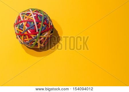 Close up of elastic ball on a yellow background.