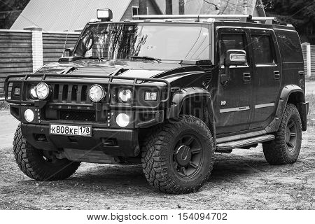Black Hummer H2 Vehicle Stands On Country Road