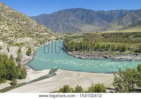 Confluence of Big Yaloman inflow into the river Katun. Low water. Altai Mountains Russia. Sunny summer day.