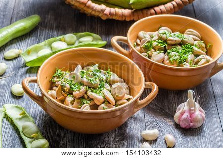 Closeup of broad beans with parsley and garlic