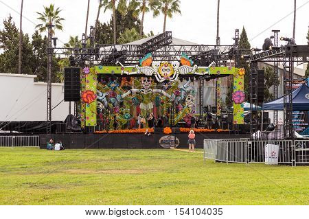 Los Angeles, CA, USA - October 29, 2016: Flower and skeleton music stage at Dia de los Muertos, Day of the dead, in Los Angeles at the Hollywood Forever Cemetery grounds. Editorial use only.